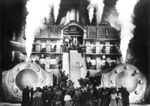 """ARCHIV - Eine aufgebrachte Menschenmenge steht vor einem dampfenden Maschinengebäude - Szene aus """"Metropolis"""" (Archivfoto von 1926). Der legendäre Stummfilm von Fritz Lang wird auf der nächsten Berlinale im Februar 2010 in einer Galavorstellung erstmals in einer restaurierten Fassung der Öffentlichkeit gezeigt. Über Jahrzehnte hinweg galten entscheidende Teile des Films von 1927, der 2001 als erster Film in das UNESCO-Weltdokumentenerbe aufgenommen wurde, als verschollen. dpa (zu dpa 0542 vom 29.10.2009) - nur s/w - +++(c) dpa - Bildfunk+++"""